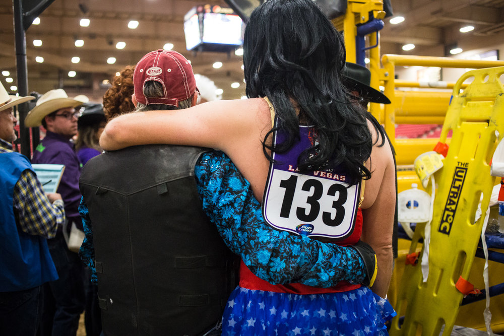 David Lawson, dressed as Wonder Woman, embraces another contestant during the Wild Drag Race at the World Gay Rodeo Finals in Las Vegas, NV.