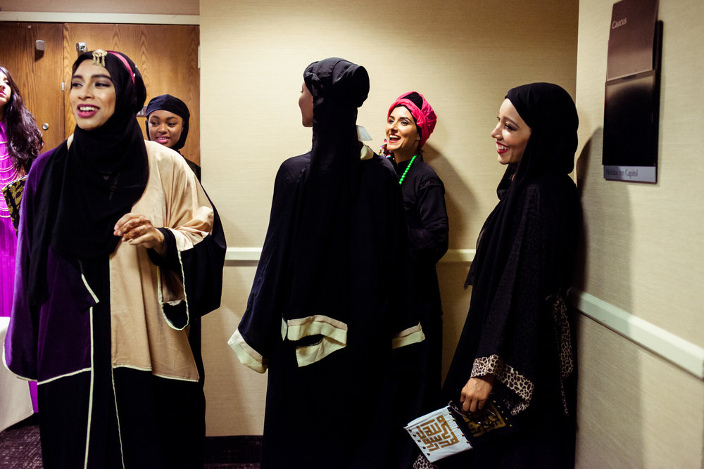 Models get ready backstage. Reaching All HIV+ Muslims in America (RAHMA) hosted a fashion show in Washington, DC on Aug. 16, 2014. The clothing and accessories are all made by Muslim women designers from around the US.