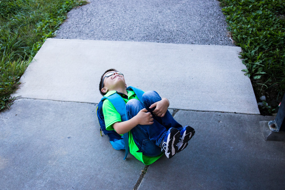 "After his mom picked him up from school, Treven curled up on the sidewalk outside before bouncing back up again. Treven also has ADHD and needs medication to help him focus during the day in school. Even though he can be a lot to handle when he's hyper, ""it's hard to stay mad at him for too long,"" Bettina says."