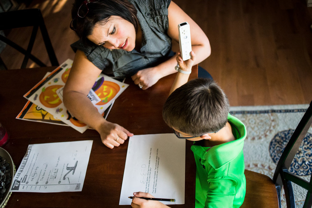 "Bettina helps Treven do his homework after school on Sept. 22, 2015. ""Maybe other parents would have more discipline with him, but his day at school is so structured,"" Bettina says."