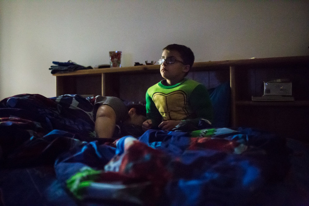 Bettina falls asleep while Treven watches Jumanji to calm down. Being a night owl, Treven needs medication to fall asleep, and his mom usually hugs him while watching a movie in his room to help him relax.