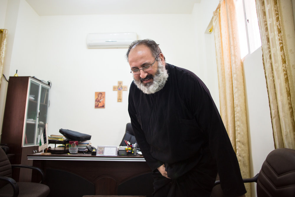 Father Dimitrius Samawi, the priest of the Orthodox Church in Mafraq, Jordan, sits in his office on Nov. 4, 2016. Father Dimitrius described it as his Christian duty to be a force for good in the Syrian refugee community, especially to help the children, no matter what religious background they come from.