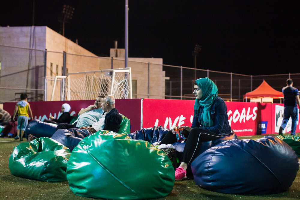 Football fans sit and watch televised matches at King Abdullah Park during the FIFA U-17 women's world cup, hosted in Jordan in 2016.