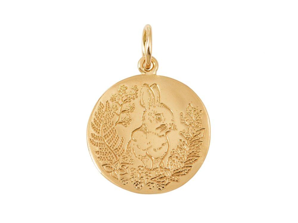 Marie-de-Beaucourt-x-Myrtille-Beck-gold-pendants1.jpg