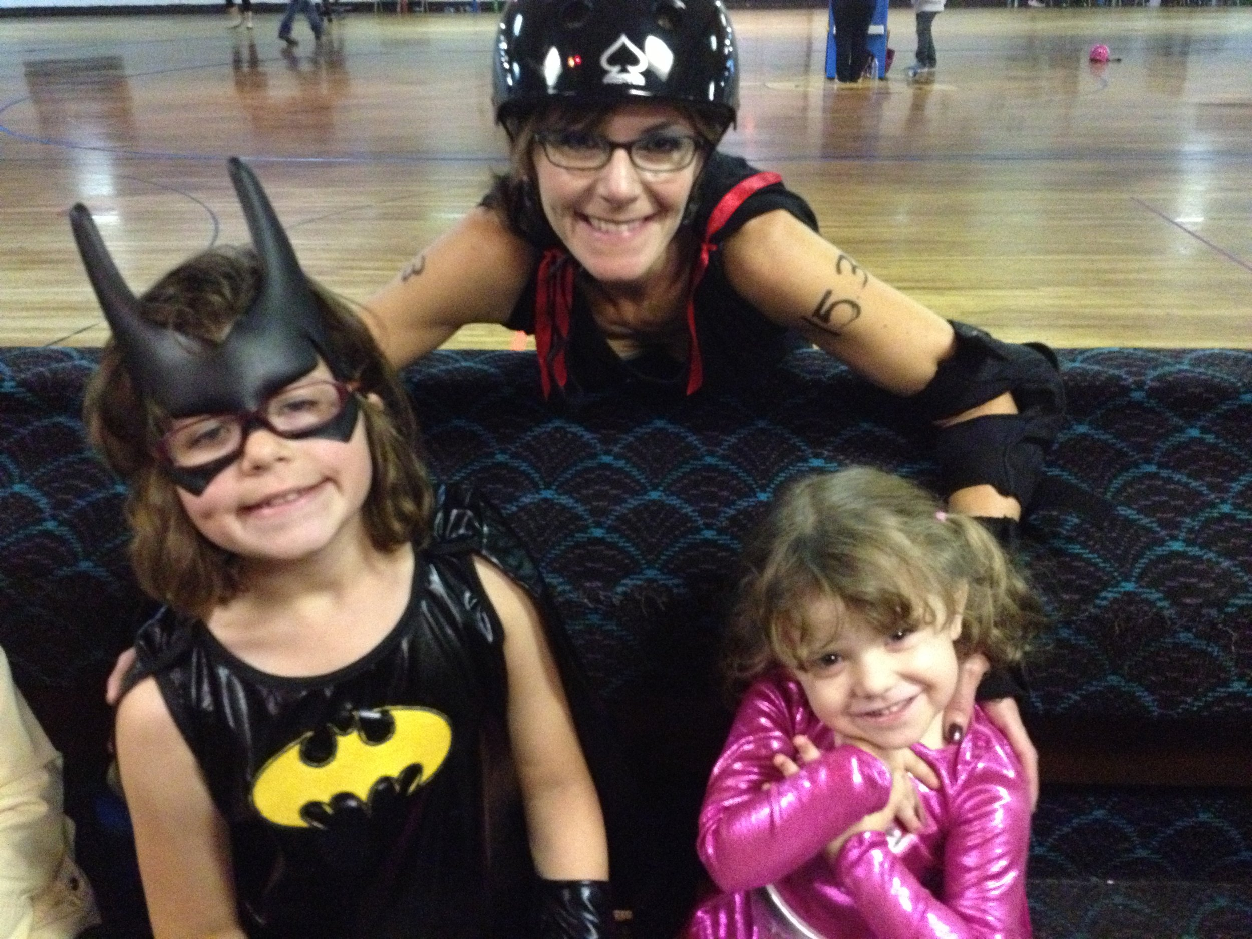 Sugar McMayhem and two of her Mighty Girls.
