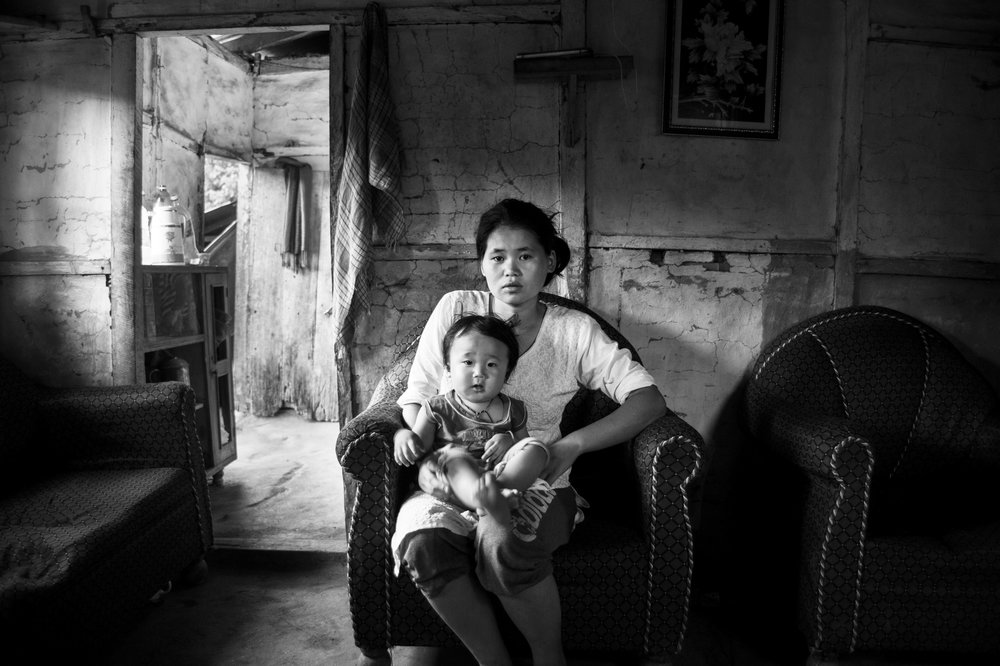 Bandhana, the wife of slain Gorkhaland supporter Sunil Rai, with their year-old son Annirudh at their home in Rellin g.