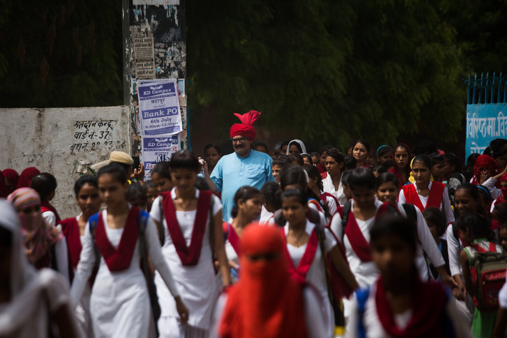 """Currently, one Lal Tau (""""uncle wearing a red turban"""") travels through all of Haryana with his long stick to fend off the young men who line up outside schools like this one in Ballabarh, making lewd comments and offering girls rides on their motorbikes."""