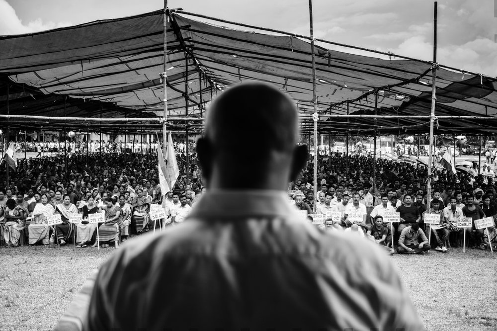 Hagrama Mohilary, the Chief of the Bodoland Territorial Council, addressing a large crowd that had gathered to condemn the massacre at the Friday market.