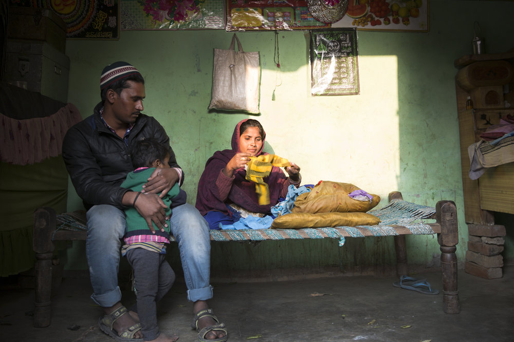 """26 year-old Zubair recollects how bodies were being cut with wood cutting machines when he ran from the Lisad Hasanpur. His 9 month pregnant wife, fell and within 10 days had her son premature. He had to give his wife blood as they didn't have anything to eat during the last days of her pregnancy. Now he is 3.5 years old. His daughter who was born in the camp died of meningitis. His wife has sewn all her dead daughters clothes into the pillow case on which they sleep. Everything gets stolen otherwise. """"No point keeping them though since we wouldn't have anymore kids now,"""" she says with a vacant look on her face. They currently live in Fala-e-eam colony in Jaula their room leased to them by the Jamait only for 5 years."""