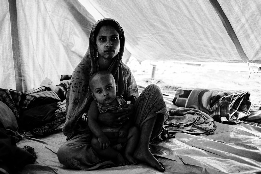 Ajmala Khatun, 21, hid in an outhouse for almost three hours, hearing bursts of gunfire and smelling burning thatch before being rescued by the police.
