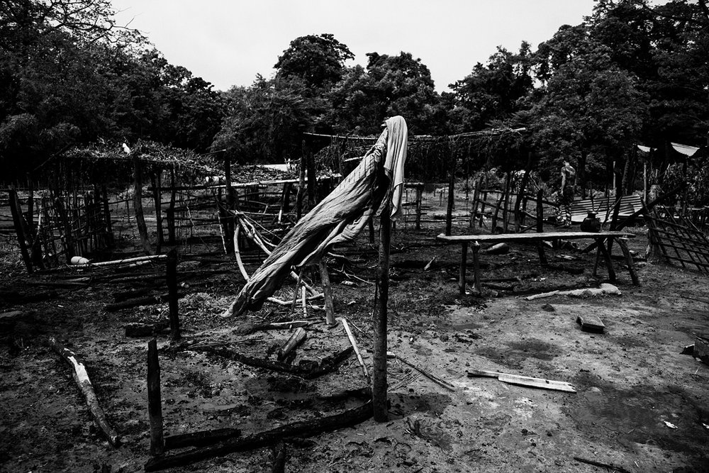 Only the frames of houses remained in N.K. Khagrabari, one of the villages hardest hit by violence.