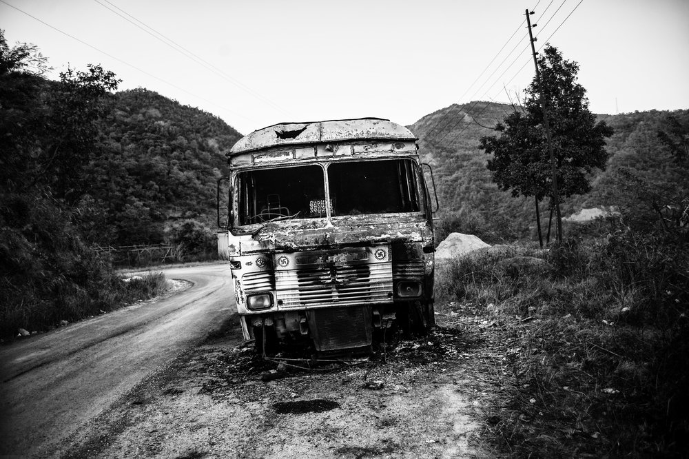Mark of anger: A burnt truck on National Highway 2 en route to Imphal in Senapati, Manipur.