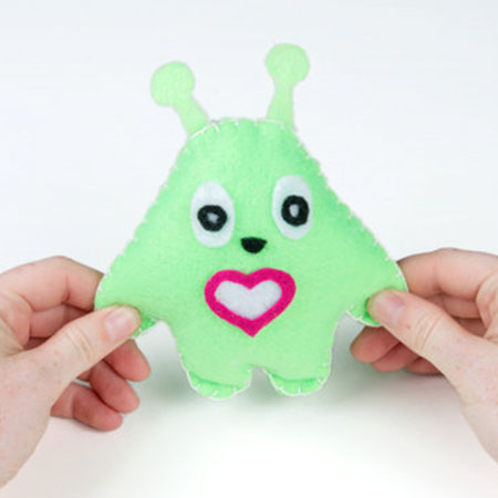 Light-Up Plush - Craft a light-up plush with LilyPad LEDs controlled by pressing a button and sliding a switch in the creature's hands.