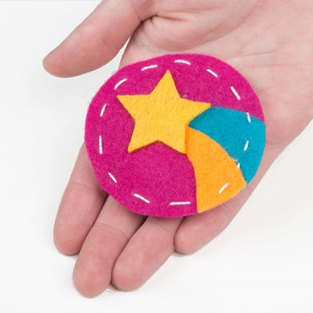 Glowing Pin - Create a quick and easy piece of e-textile art using a LilyPad LED, battery holder, conductive thread, and coin cell battery.
