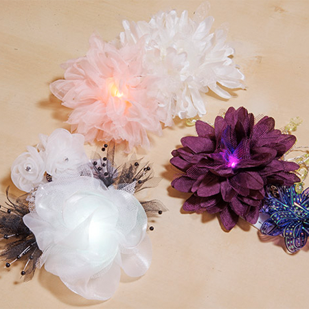 Light-Up Silk Flower Corsage - Combine a silk flower with a built-in RGB LED and some switches to create a light-up accessory.