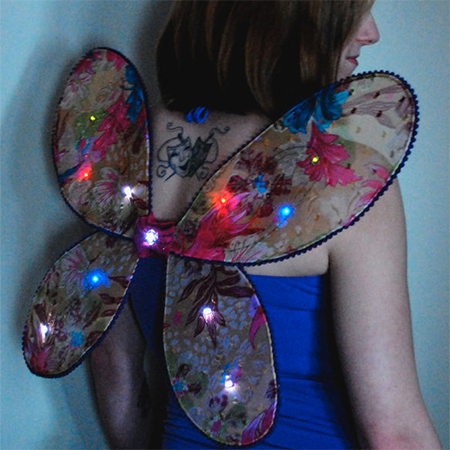 Programmable Light-Up Wings - Create light patterns on your fairy wings using a microcontroller called Schemer by Aniomagic.