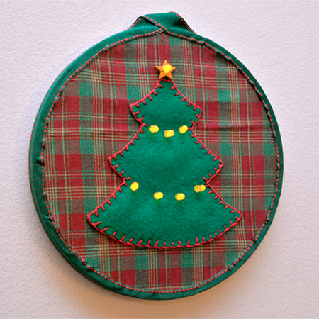 Christmas Tree LED Embroidery - This pattern uses LEDs as the string of lights on a felt Christmas tree appliqué.