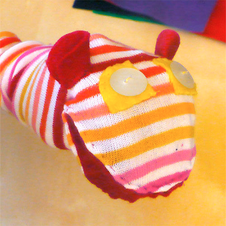Talking Sock Puppet - This sock puppet makes sound when you open its mouth. It is a quick and easy project to use up old musical cards instead of throwing them out.