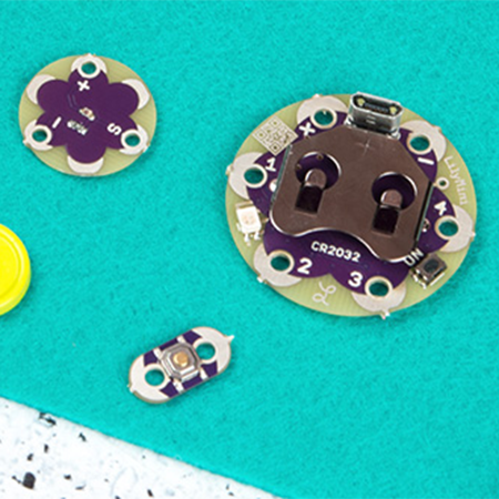 Getting started with LilyPad - An introduction to the LilyPad ecosystem - a set of sewable electronic pieces designed to help you build e-textile projects.