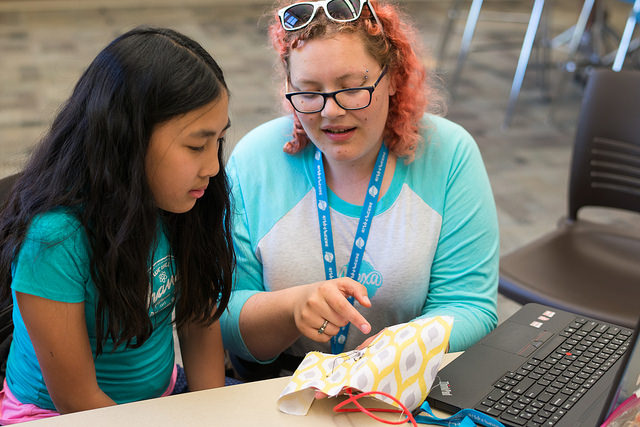 An instructor at  iD Tech's Alexa Cafe  collaborates with a student prototyping with LilyPad sewable electronics. Photo via  SparkFun on Flickr