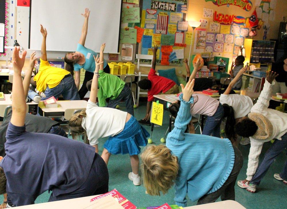 yoga triangle whole class.jpg