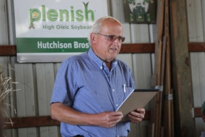 Bobby Hutchison addresses the crowd at his farm during the Conservation in Action Tour.