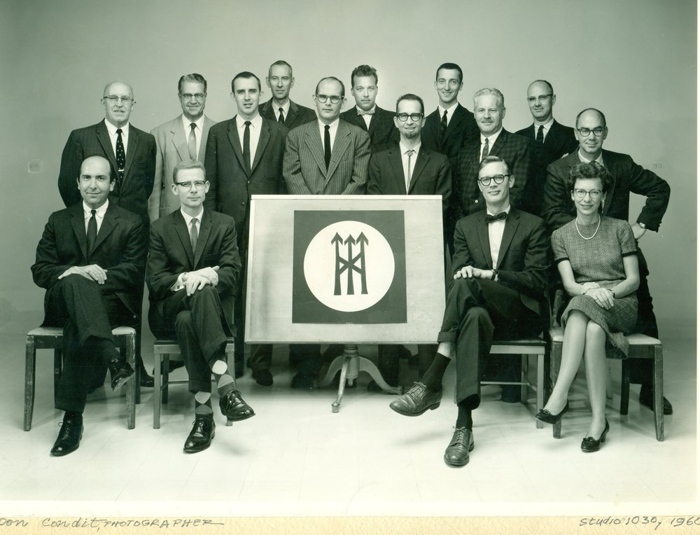 Studio 1030, 1960. Charles Politz, seated left. Bennet Norrbo, standing third from left. Dick Wiley, standing far right. Joe Erceg, standing second from right, far back.