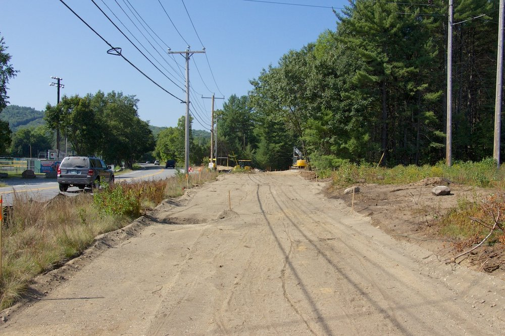 New trail realignment for western Mast Road crossing