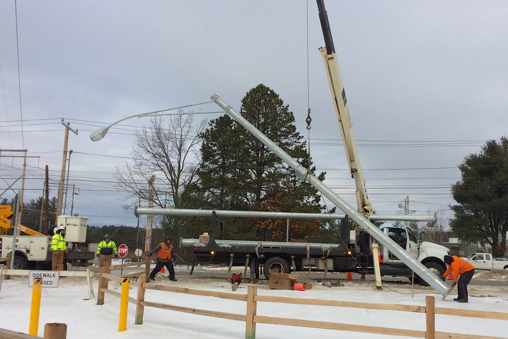 Lifting the new light post at western Mast Road crossing