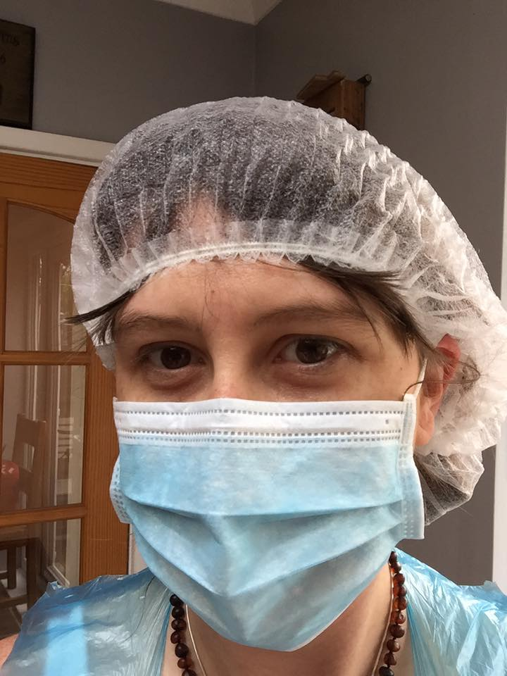 Sarah Marsden all gowned up to prepare placenta remedies for her postpartum mums.