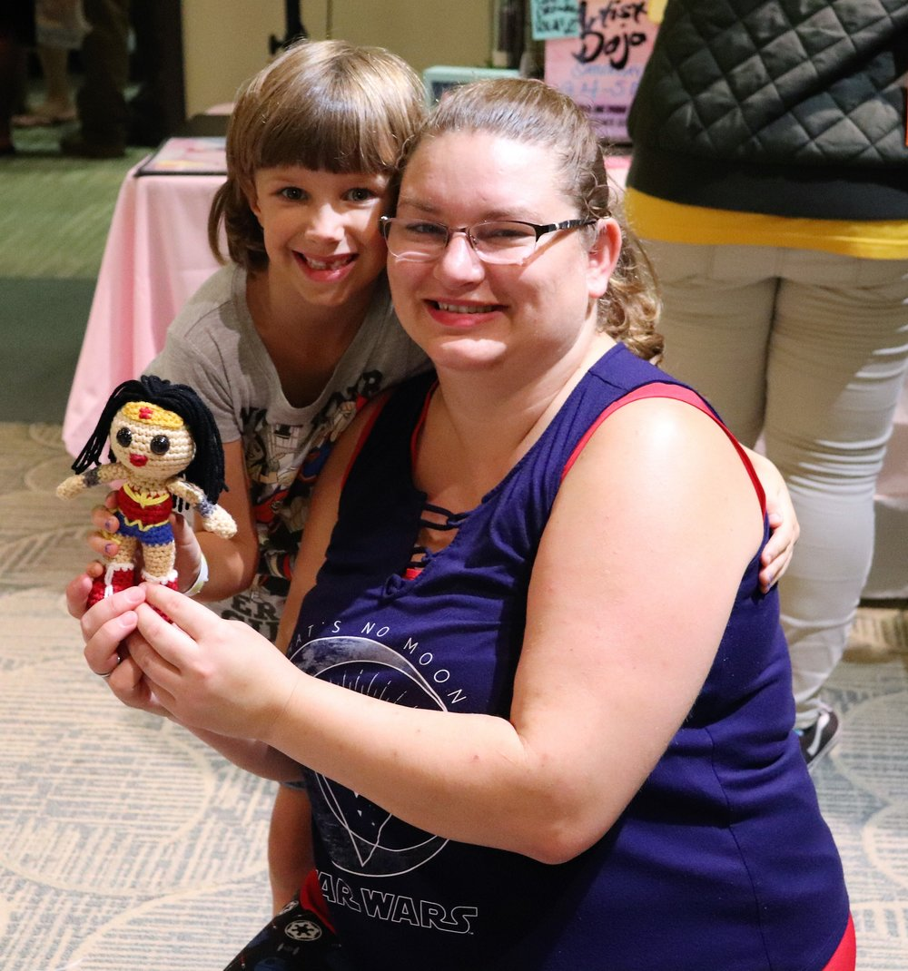 The best sell of the day! Every stitch and every hour I put in is worth every bit when I see the happiness I can spread.  This is what it is all about! Shear joy and big smiles.  Warmed my heart to see her skip and jump away from the table with her new Wonder Woman doll.
