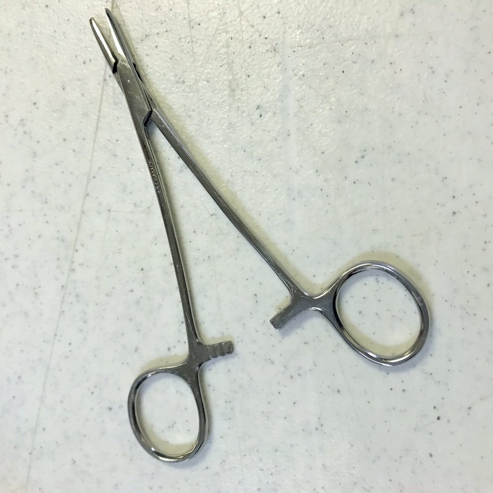 This surgical tool known as a hemostat can be very useful for hand stitching.