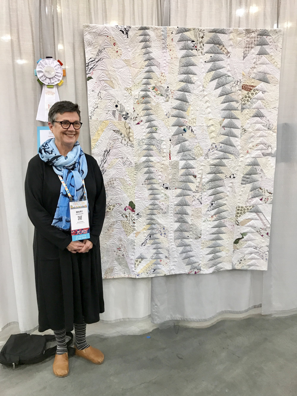 "Mary Keasler and her award-winning quilt ""Free Motion"""