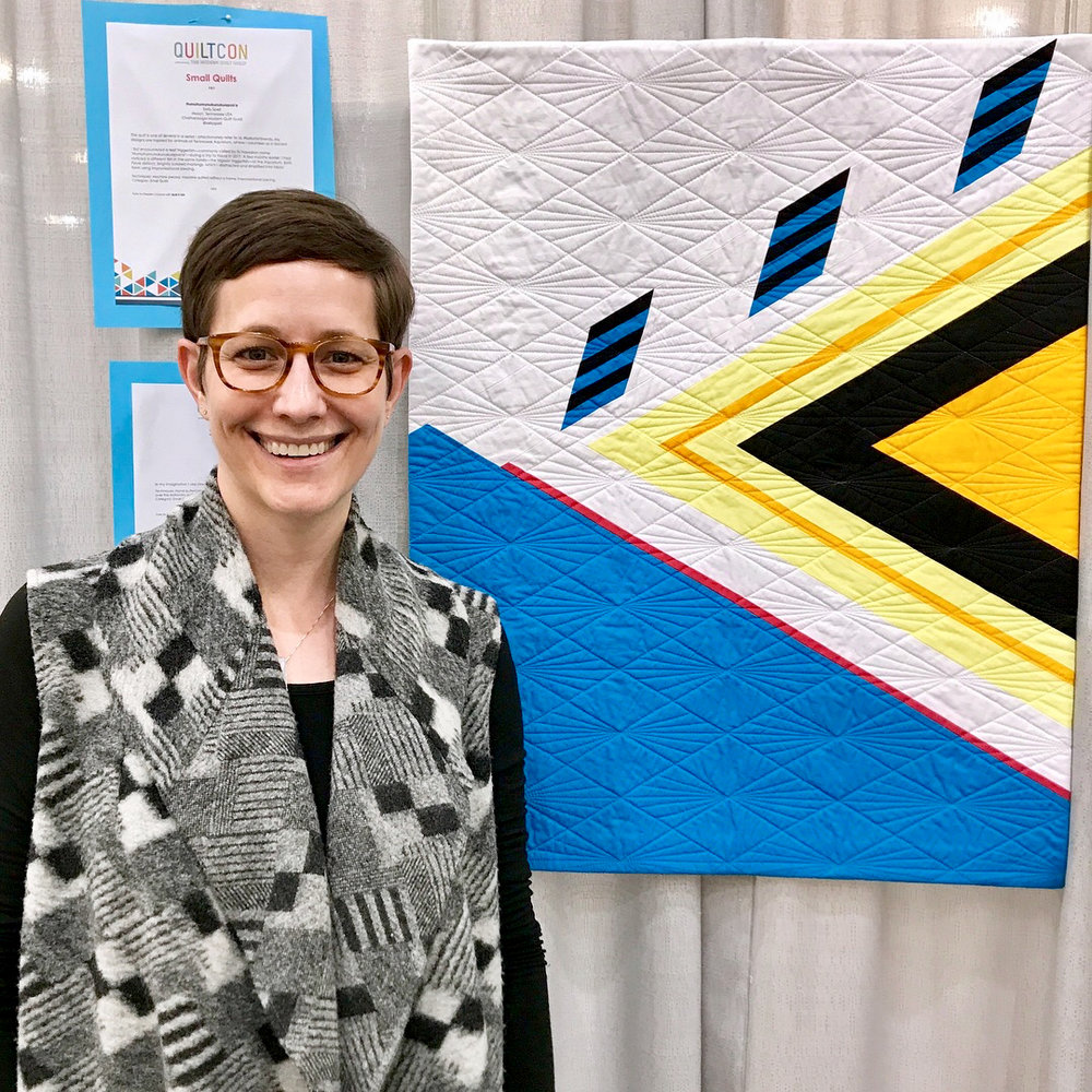 "Kelly Spell and her quilt ""Humuhumunukunukuapua'a"""