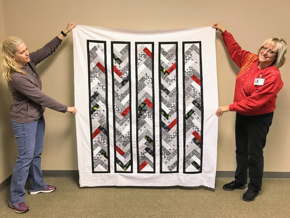 Karen (right) matches her jelly roll quilt