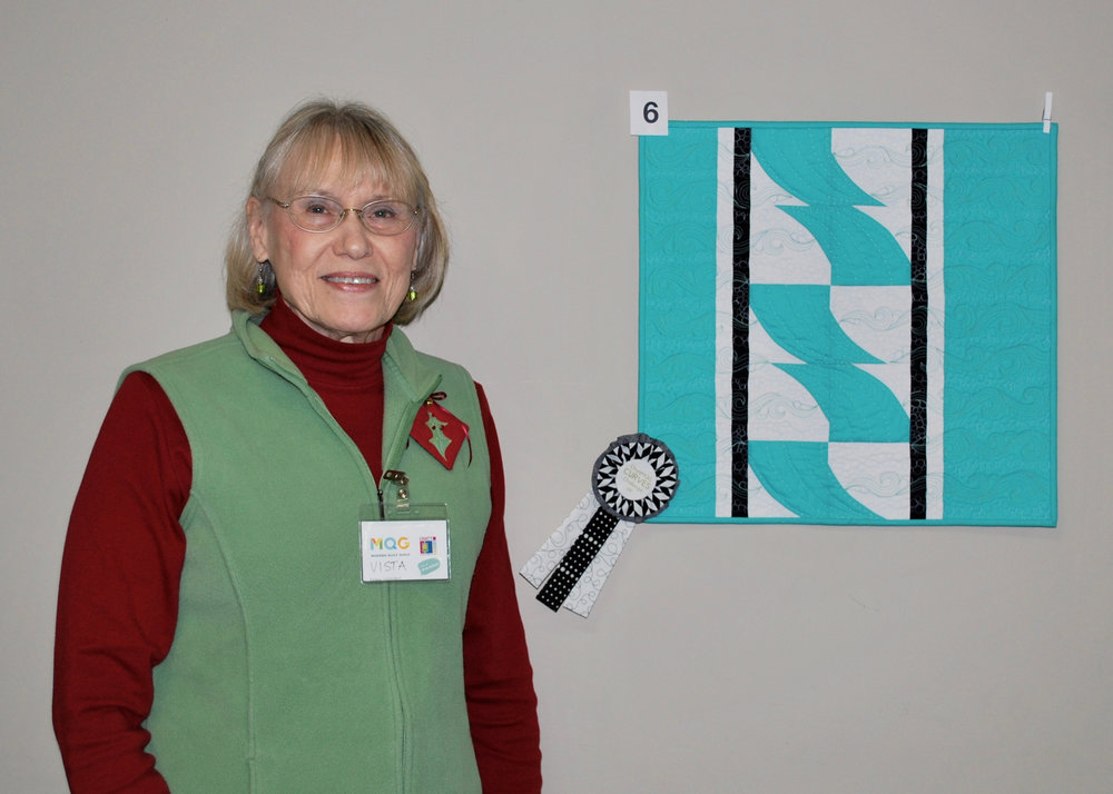 Vista Mahan and her winning quilt