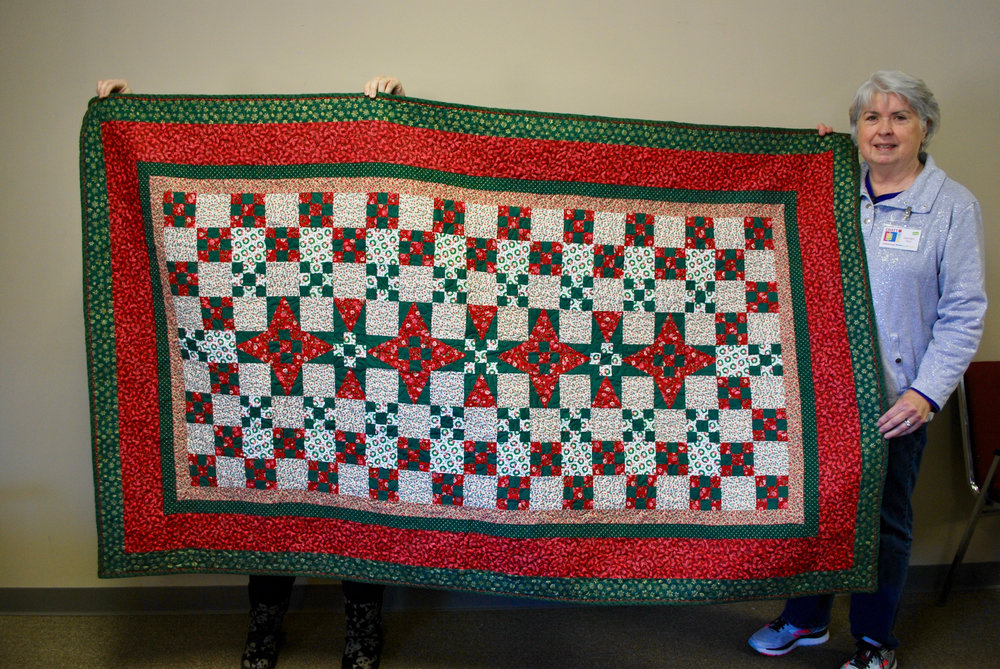 Carolyn R. finished a Christmas quilt started by her mother