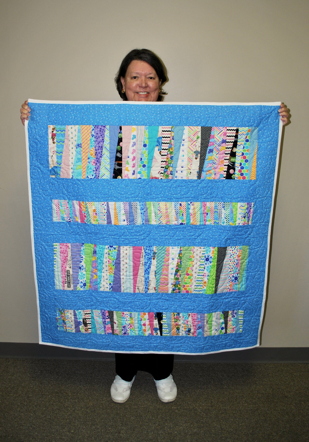 Beverly enjoyed sewing scraps together for this quilt