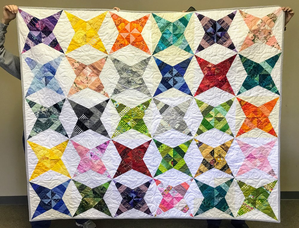 Our paper-pieced stars were quilted and bound by Karen S.