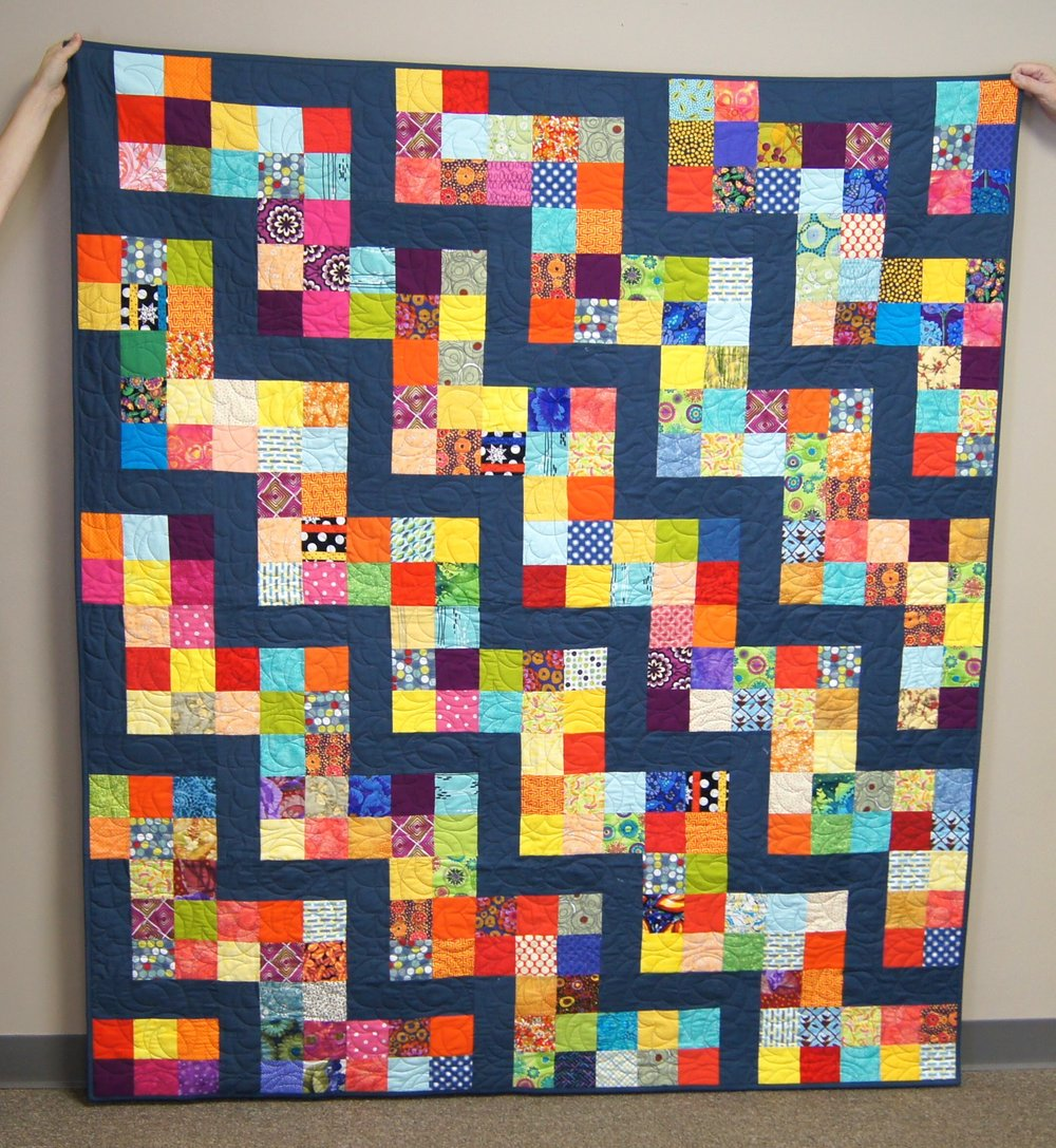 This was assembled by Martha G., quilted by Beverly, and bound by Jean.