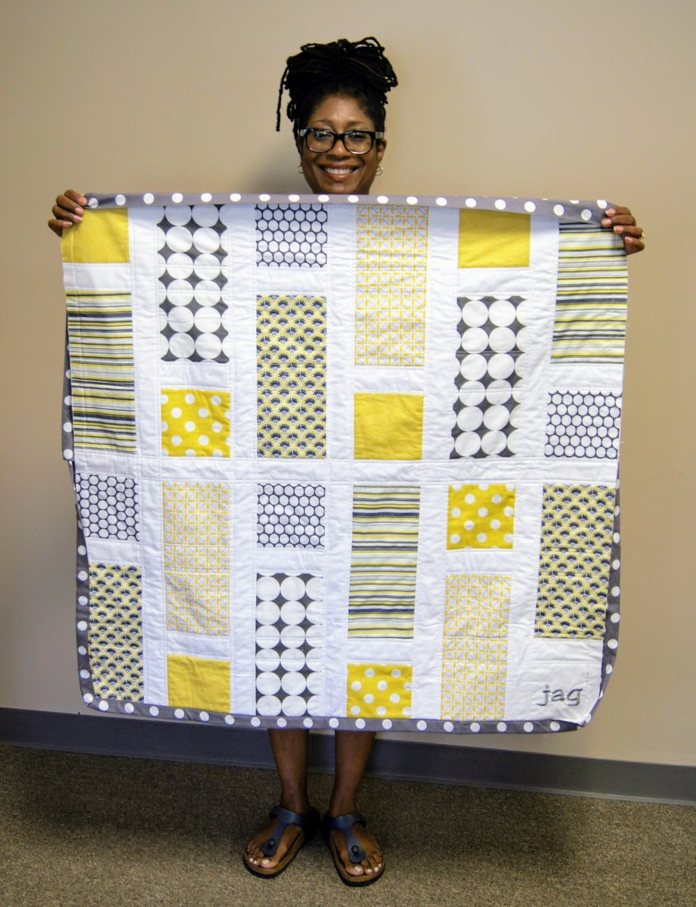 An adorable baby quilt made by Carolyn P.