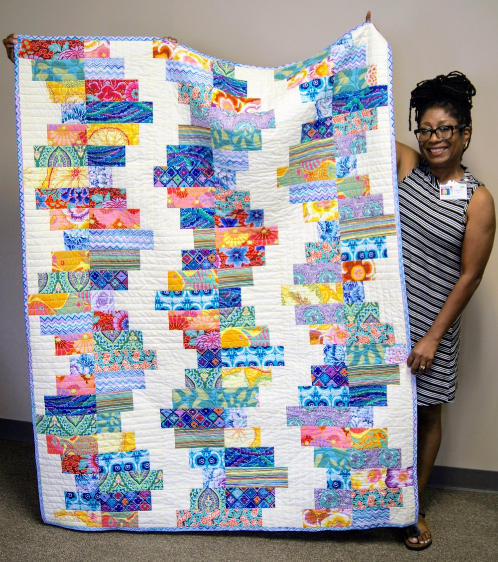 Carolyn P. and her bright summer quilt
