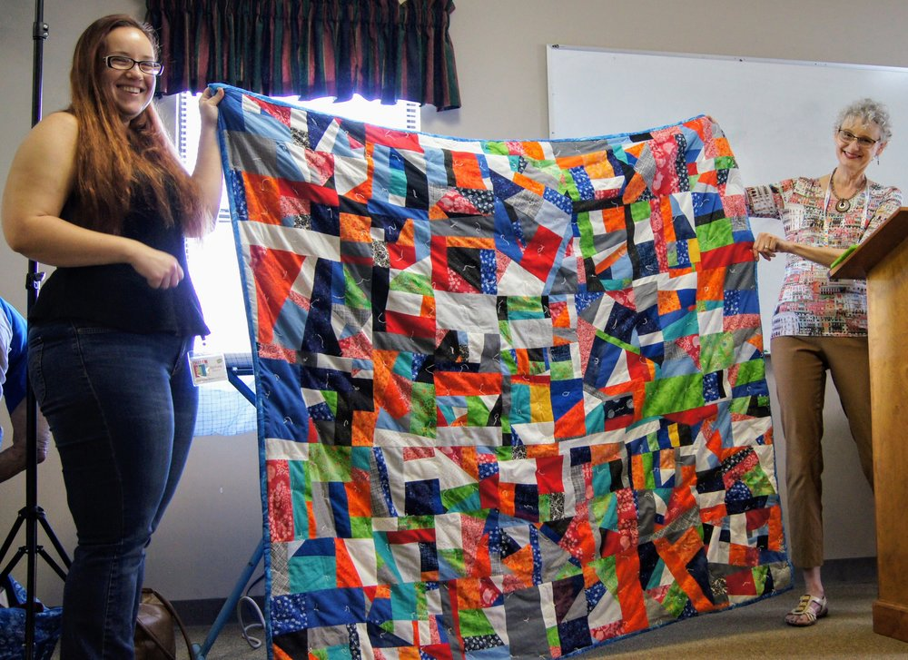 Stephanie (left) hand-tied her improv quilt