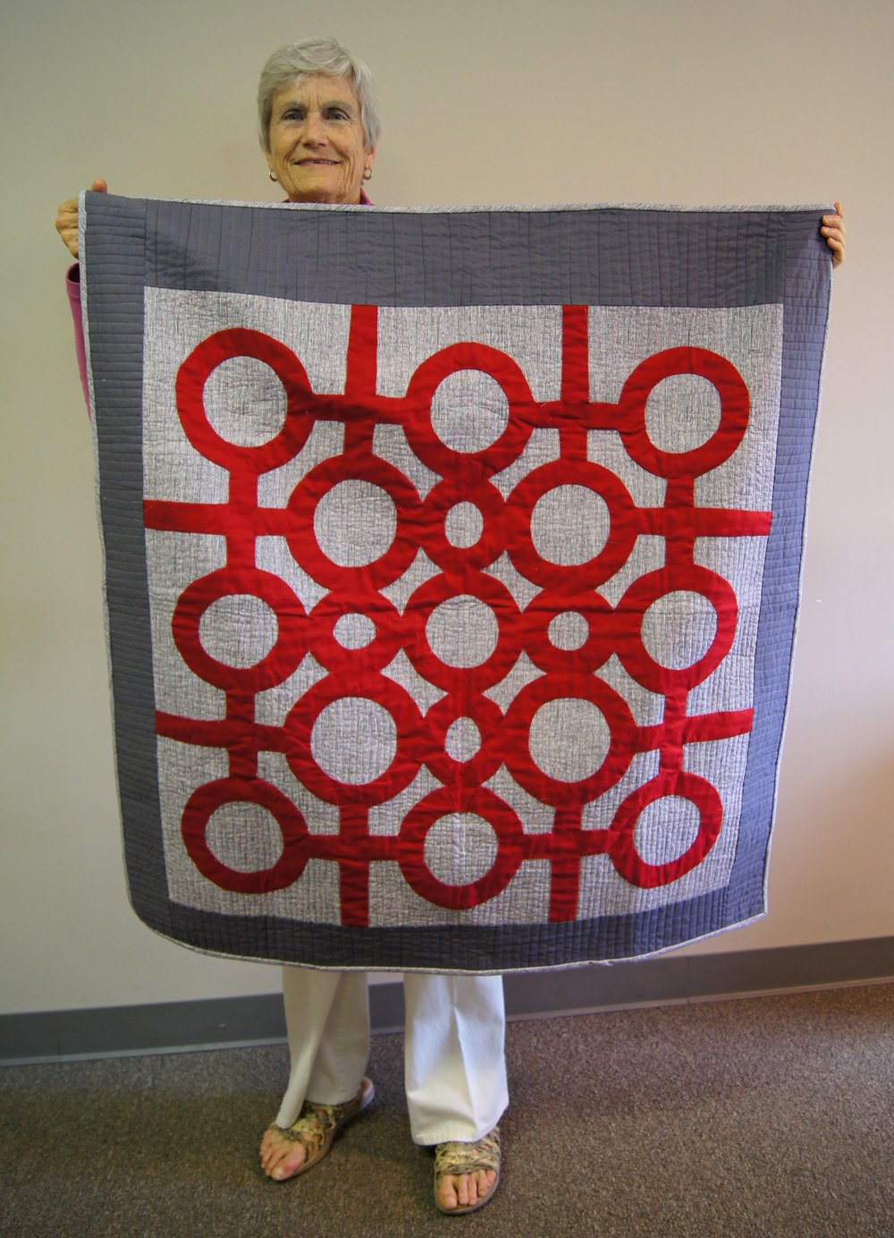 Whole-cloth appliqué quilt by Martha Griffin