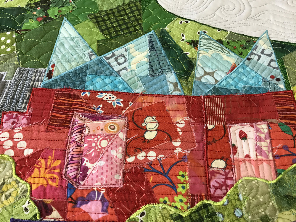 A closeup of the Tennessee Aquarium in Audrey Workman's Chattanooga riverfront quilt.