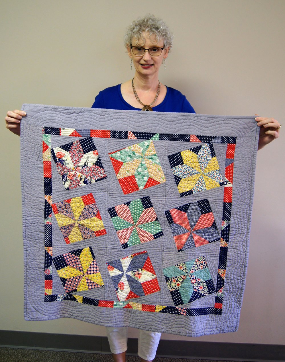 Denise Ohlman and the quilt she made in Mary Kerr's workshop