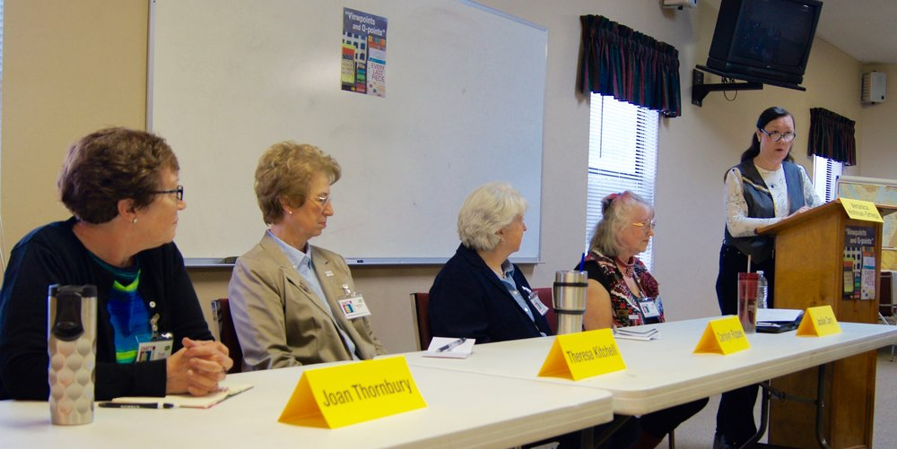 Veronica moderates a panel discussion by (left to right) Joan, Theresa, Carolyn and Jackie.