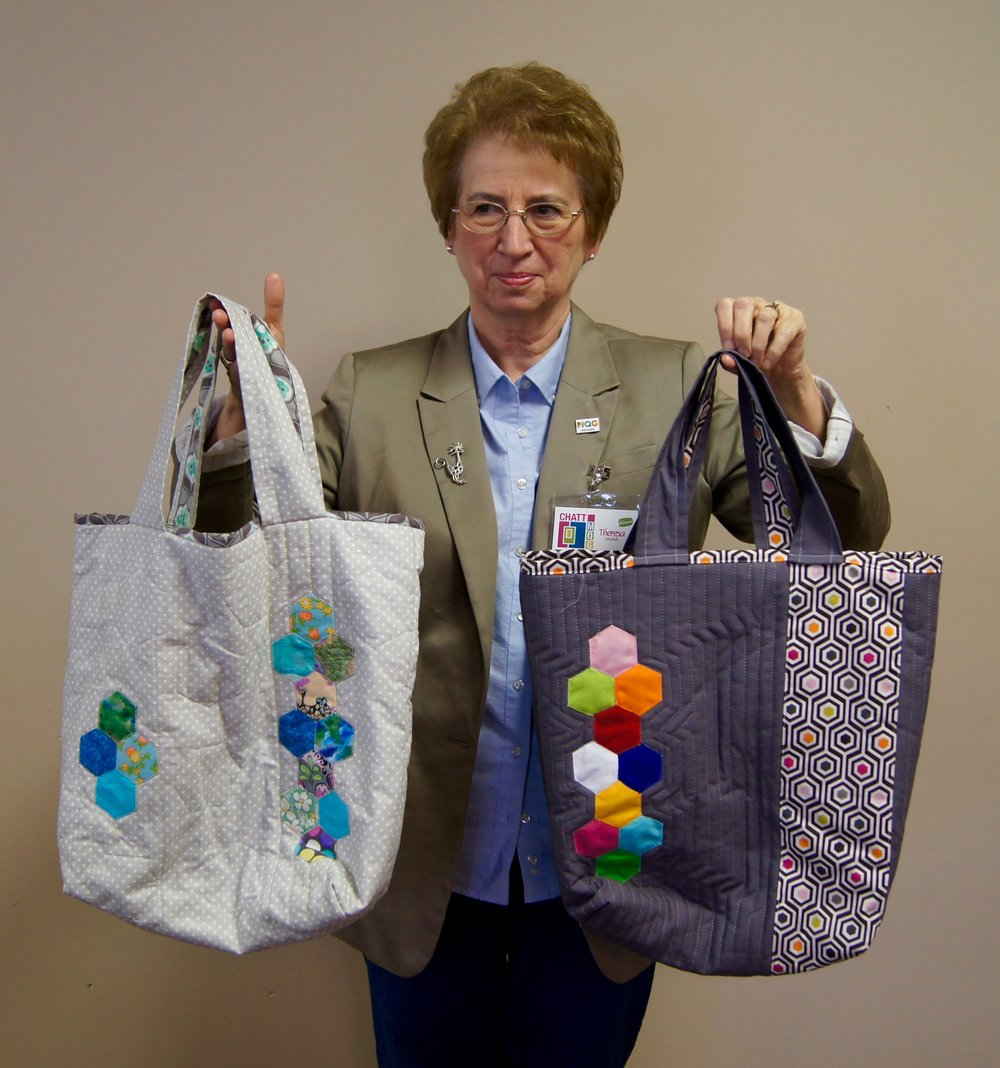 Theresa Kitchell made bags with appliqué hexies