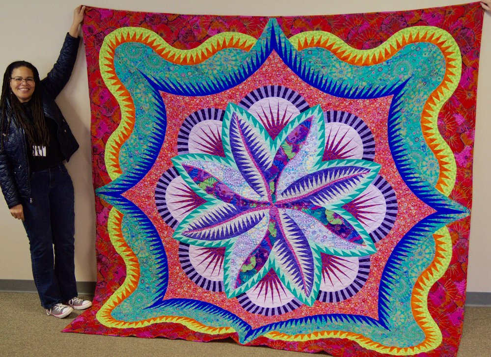 Vanessa King and her colorful Judy Niemeyer quilt