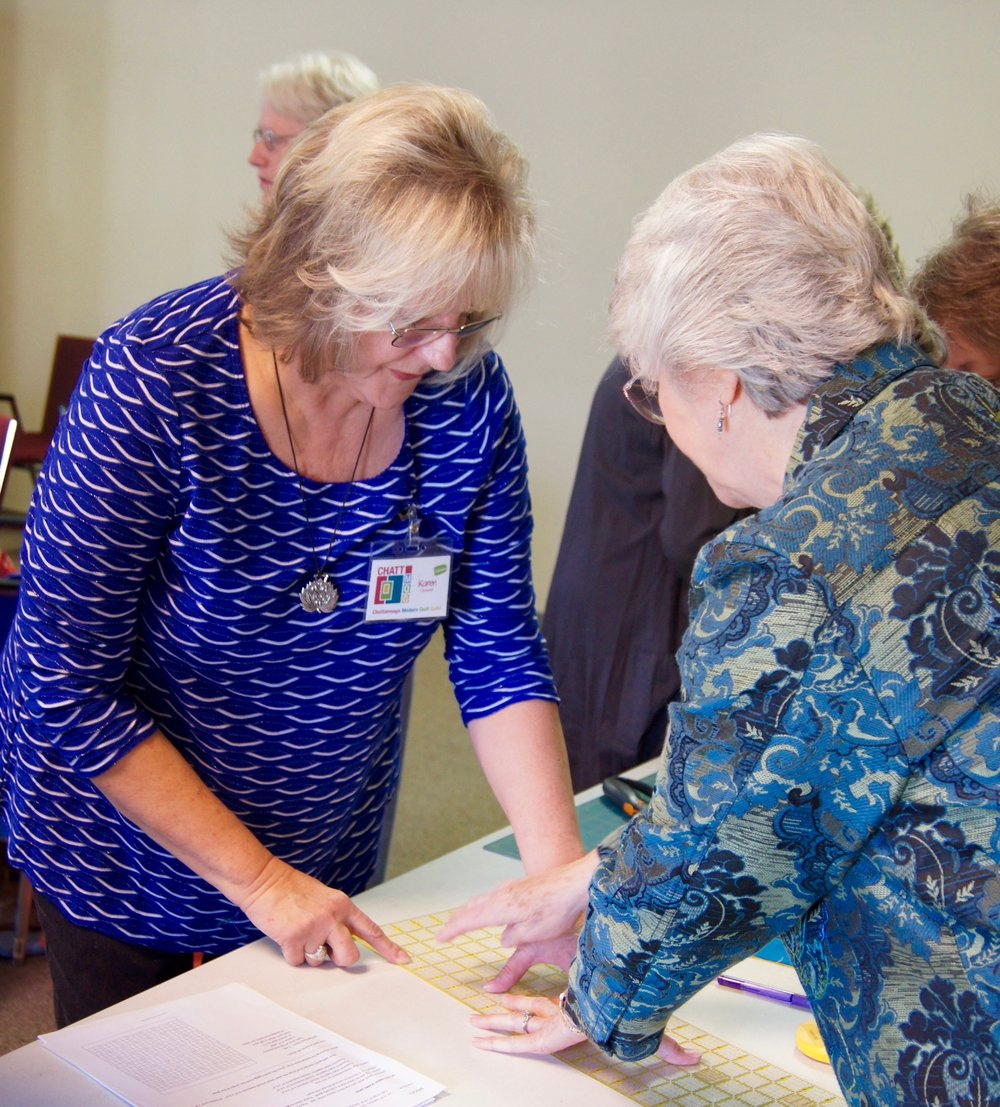 Karen (left) discusses accurate cutting with Delores